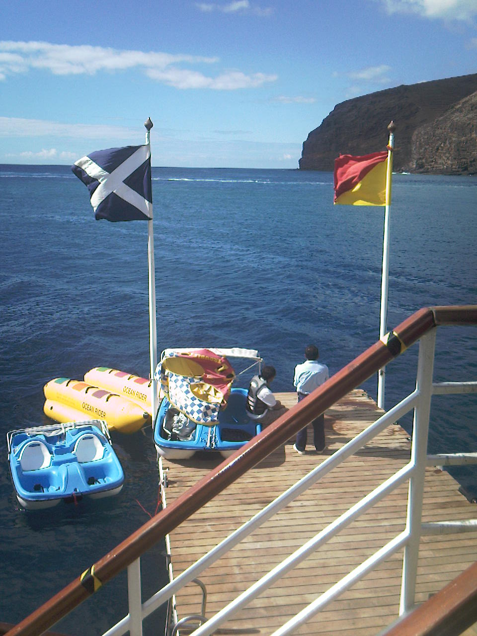 The pedalos and inflatable banana boat alongside the floating water sports deck in San Sebastian de la Gomera