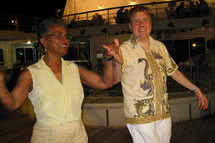 Gertrude & Martin dancing on deck on tropical night